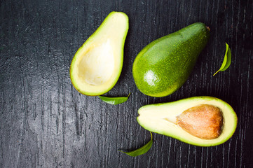 Avocado slices on dark wooden table