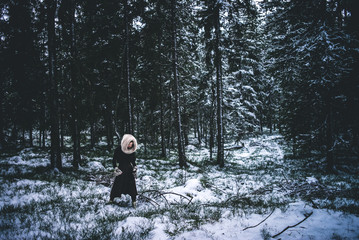 girl in snowy forest
