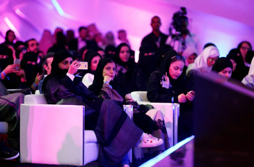 People attend the performance of the actor John Travolta at APEX Convention Center in Riyadh