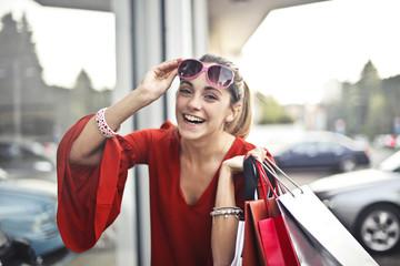 Happy girl holding handbags
