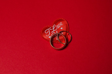wedding rings and a red heart
