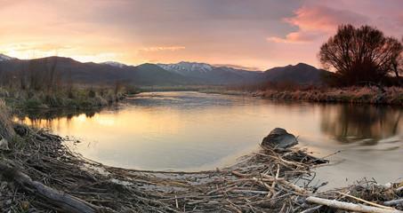 Wall Mural - Rural river sunset reflection, Utah, USA.