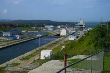 Agua Clara locks of Panama Canal, Panama with passing ship