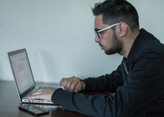 Young business man multitasking