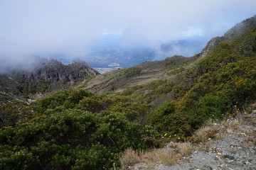 A view from the top of Baru Volcano, Panama to the valley with white fog in the distance