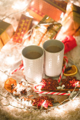 Hot chocolate drink with biscuits under the christmas tree