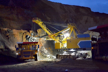 Loading rock in the quarry at night