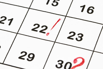 Close up a date 30 with red circles on a calendar (end of the month)