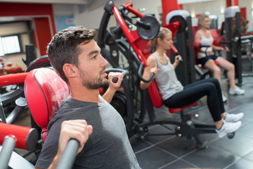 sport people working out muscles on weight lifting gym machine