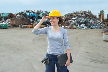 woman posing in the junkyard