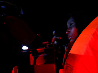 A migrant sits in a RHIB from  MV Aquarius, a search and rescue ship run in partnership between SOS Mediterranee and Medecins Sans Frontieres, after being rescued from a rubber dinghy in the central Mediterranean 69 nautical miles off the coast of Libya