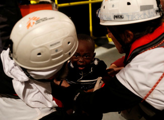 A migrant child cries after being brought aboard MV Aquarius, a search and rescue ship run in partnership between SOS Mediterranee and Medecins Sans Frontieres, after being rescued in the central Mediterranean 69 nautical miles off the coast of Libya