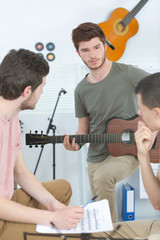 friends performing music in a recording studio