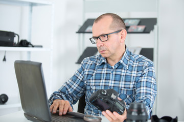 male photographer using digital laptop lifestyle