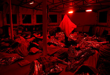 Migrants sleep on the deck of MV Aquarius, a search and rescue ship run in partnership between SOS Mediterranee and Medecins Sans Frontieres, after being rescued in the central Mediterranean 69 nautical miles off the coast of Libya