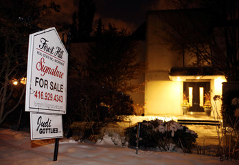 A For Sale sign stands outside the home of billionaire founder of Canadian pharmaceutical firm Apotex in Toronto