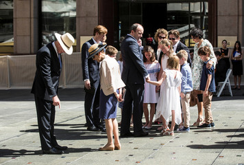 Family members of barrister Katrina Dawson look at the site of a permanent memorial honouring the lives of Dawson and cafe manager Tori Johnson, victims of the 2014 siege at Lindt Cafe, in Martin Place, Sydney, Australia