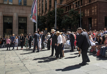 Dignitaries, family and close friends inspect the permanent memorial honouring the lives of cafe manager Tori Johnson and barrister Katrina Dawson, victims of the 2014 siege at Lindt Cafe, in Martin Place, Sydney, Australia