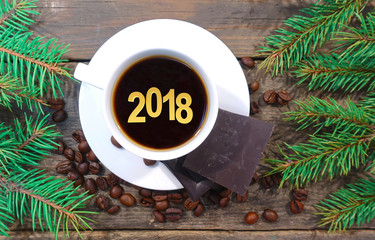 Cup of coffee with the number 2018 New Year on a Christmas background. 3D illustration