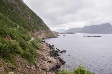 dirt road with curves on the sea towards Nyksund village in Norway