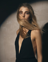 Blonde Girl in a black Dress