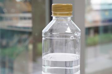 Closeup  Plastic water bottle  on the white desk