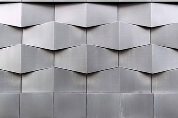 Photo sur Aluminium Batiment Urbain Close-up of gray geometric building facade