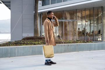 Stylish black man talking phone