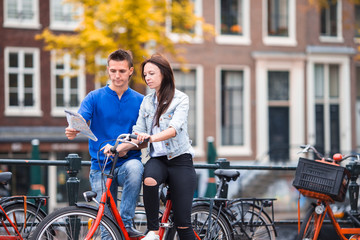 Young happy family on bikes in Amsterdam