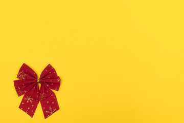 red Christmas bow on a colored background