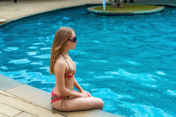 Back view of beautiful woman in swimming pool