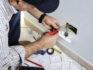 Electrician working in a residential electrical system