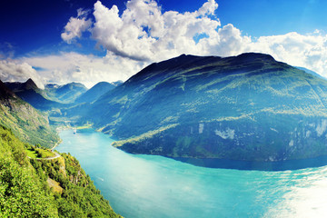 Beautiful colorful vibrant sunny Geiranger fjord Norway landscape with azure water
