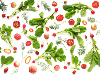 The concept of healthy eating. Pattern composition from vegetables and fruits, top view. Food background, wallpaper. Tomatoes, radish with leaves, pepper, berries, apples isolated on white background.
