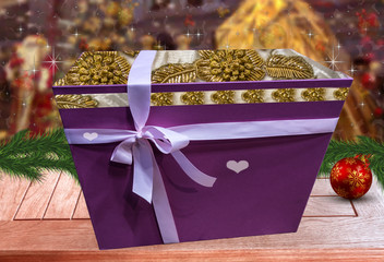 Box with gifts on a wooden table