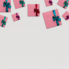 Gift boxes Top view Many stylish pink gift boxes with colorful bright ribbons on white background Photo mockup with space for text