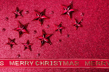 Festive decorations on red shiny background