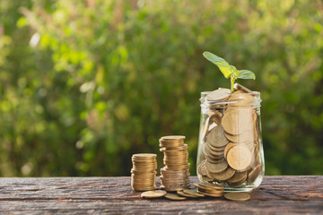 Coins in jar with money stack step growing money, Concept finance business and saving investment.