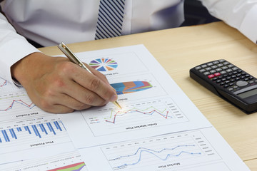 Businessman analyzing Summary report and financial  order market plan
