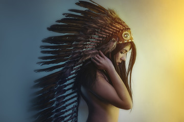 beautiful girl with plume of american indian feathers