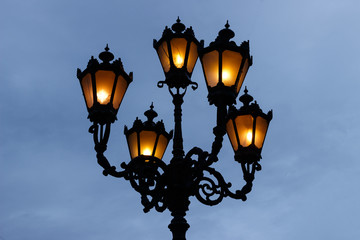 Beautiful old city lantern on a light background Fotomurales