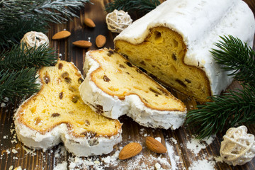 Traditional stollen and almond on the wooden background