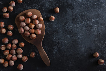 Whole Hazelnuts on a Wood Paddle
