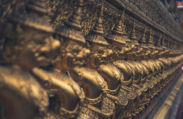 Row of gold Buddha statues in the temple