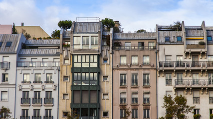 PARIS, FRANCE, on October 30, 2017. The sun lights the city street and typical architectural parts of houses of in downtown. Building facade fragment,  Fototapete