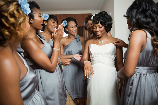 Bride and bridesmaid getting ready for her wedding.