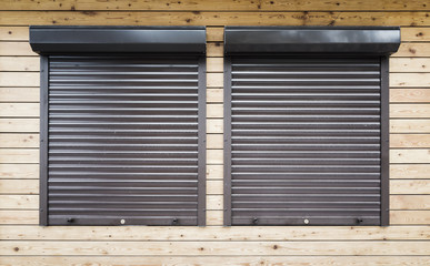 Windows protected with roller shutters