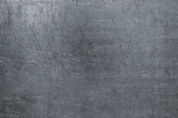 Damaged steel texture, dark metal background with scratches on the surface