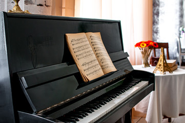Black piano with notes