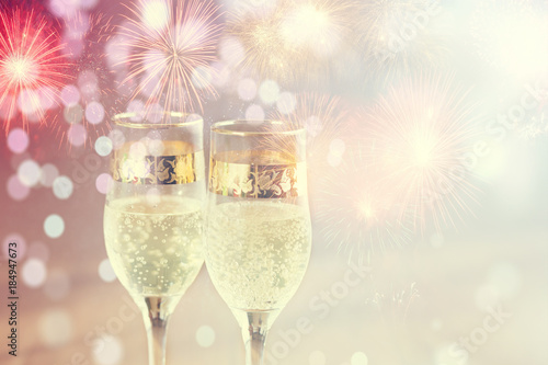 champagne glasses and fireworks new year background